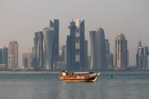 Doha skyline, and a traditional dhow in front