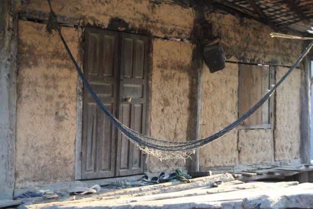 The ubiquitous hammock in a village