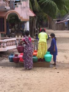 Kallar village, collecting water