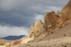 eroded rocks against dark sky