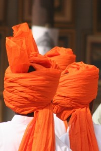 some of the band members have bright orange headdress