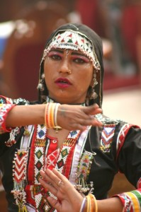 another traditionally dressed woman, dancing
