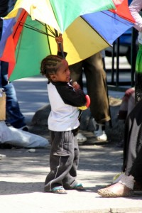 small kid, big umbrella