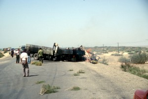 burning trucks on the road to Kashgar