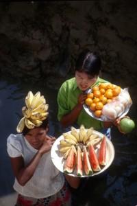 girls selling fruit along the river