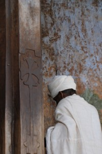 caretaker opening the Abreha we Atsbeha church