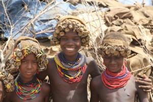 children with bottle top head dress
