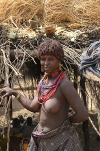 Karo woman in front of her house