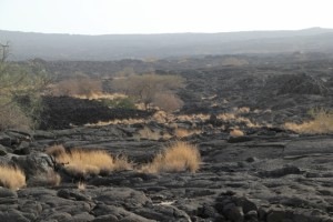 irregular surface of solidified lava on the crater slope
