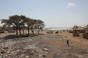no-man's land, used as rubbish dump