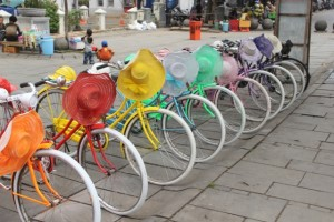 jolly-coloured bicycle rental, complete with coloured hat or helmet: you cannot get more Dutch, neither colonial!