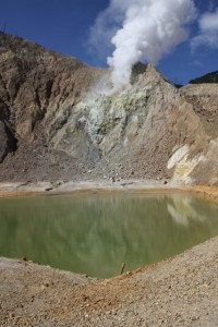 and a little further, the serene green lake of the 2002 mini-crater, with plume