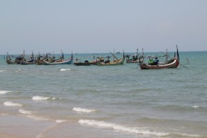 fishing boats in front of the beach