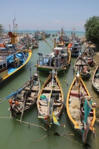 the river mouth clogged with all sizes of boats