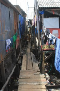 narrow passages between houses on stilts