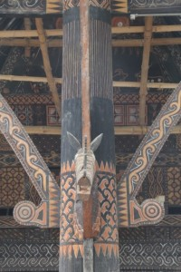 support pole extensively decorated