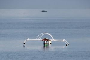 fishing boat off the beach of Ampana