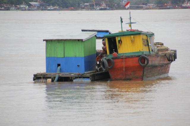 two barges in the Mahakam River outside Samarinda