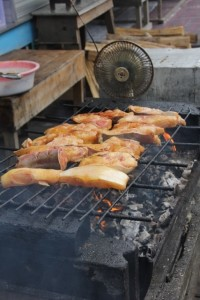 fish being grilled, note the little fan to blow the charcoal