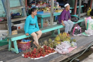 rambutan and durian for sale at a river stop in Datan Bilang