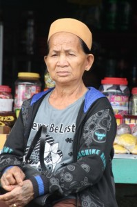 stern looking shop owner in Datan Bilang
