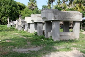 row of tombs in Umabara, the first ones, of concrete, still unadorned, awaiting a deceased king