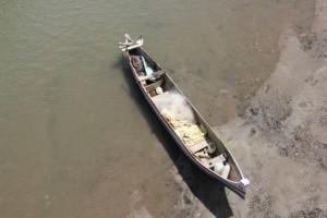 a canoe left under a bridge