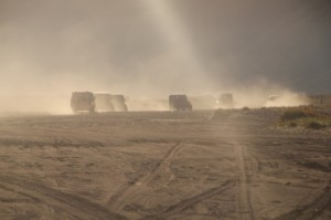 a convoy of jeeps in the sea of sand