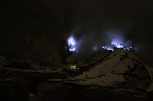 blue fire at various spots in the crater, surrounding the yellow mining spot