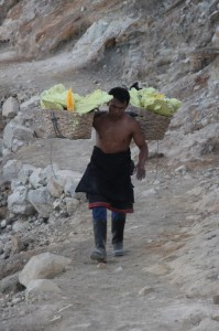 sulphur miner carrying his baskets out of the Ijen Crater