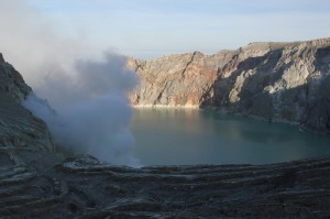 the crater lake, finally illuminated by the sun