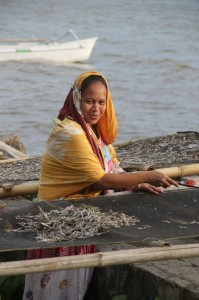 woman selecting dried fish in Polewali
