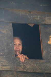 woman peeking out of one of the windows