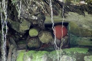 rock tomb stuffed full of dead bodies