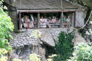 row of tau tau above the Londa cave entrance