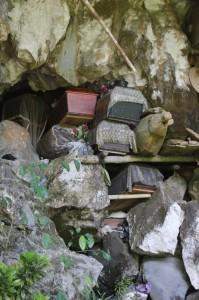 coffins stuffed in a natural fissure in a cave in Londa