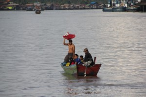 more passengers, joining the kapal biasa mid-river