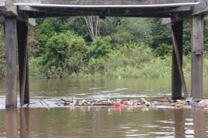 rubbish collecting under a small bridge