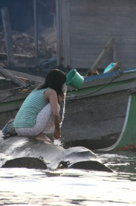 girl washing near the market