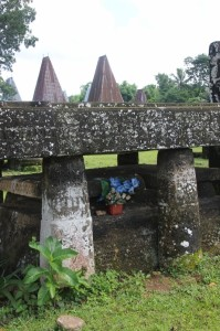 plastic flowers decorate the tomb in Kampung Pasunga