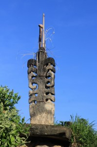 decorated stone sculpture in the centre of Kampung Waigalli