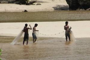 fishermen active along the beach