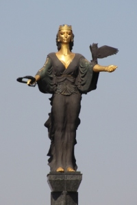 the sculpture of Saint Sofia towering over the city