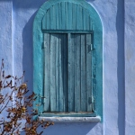 a blue church window in rural Moldova