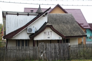 this is a general store, with wooden shingles as roof cover