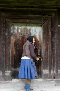 the key keeper opening the Sat Sugatag church
