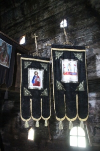 inside the Sat Sugatag church, few frescoes, but many standrads, still in use for processions