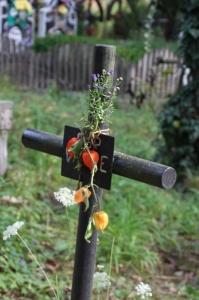 a simple metal cross outside the Desesti church