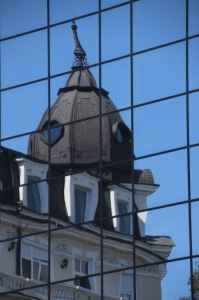 old and new: turn of the century building reflected in modern glass wall in Sofia
