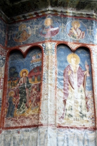 including remains of frescoes on the outer walls